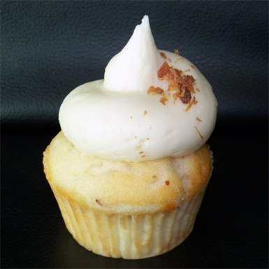 Maple Bacon: Vanilla cake with bacon and maple syrup inside topped with maple buttercream.
