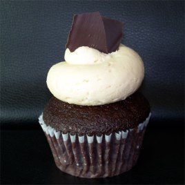 Peanut Butter Cup: Chocolate cake topped with peanut butter buttercream and dark chocolate shavings